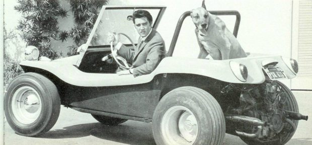 Elvis with his dog in a dune buggy. 1968